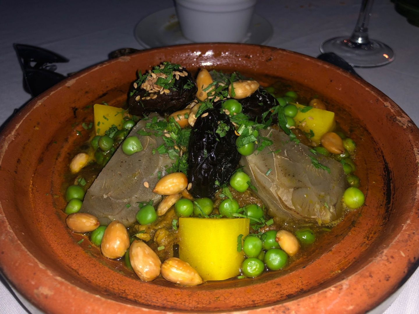 Lamb Tagine With dates , nuts , artichokes and peas
