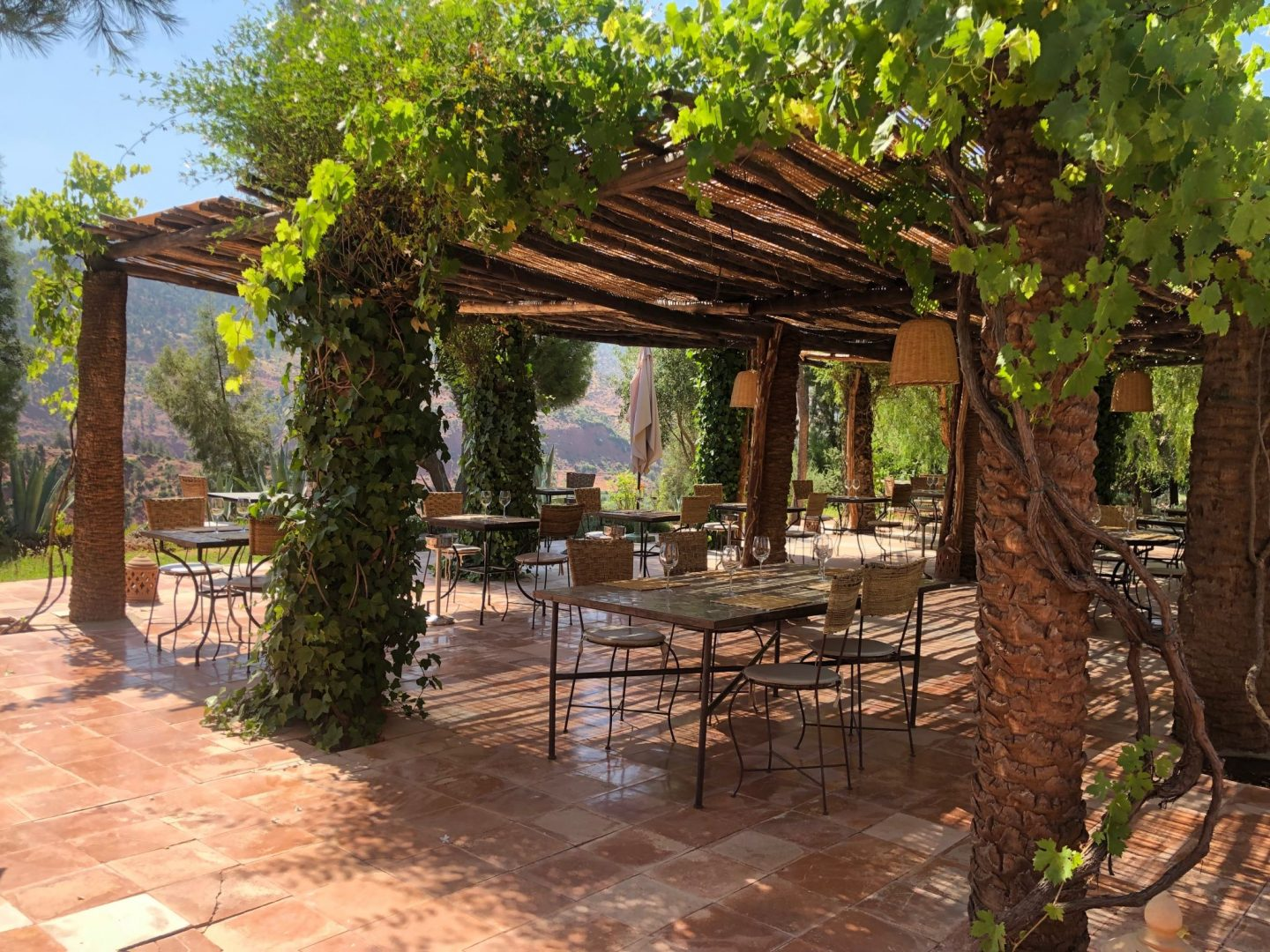 Al fresco dining at Kasbah Bab Ourika rustic luxury hotel in the Atlas Mountains