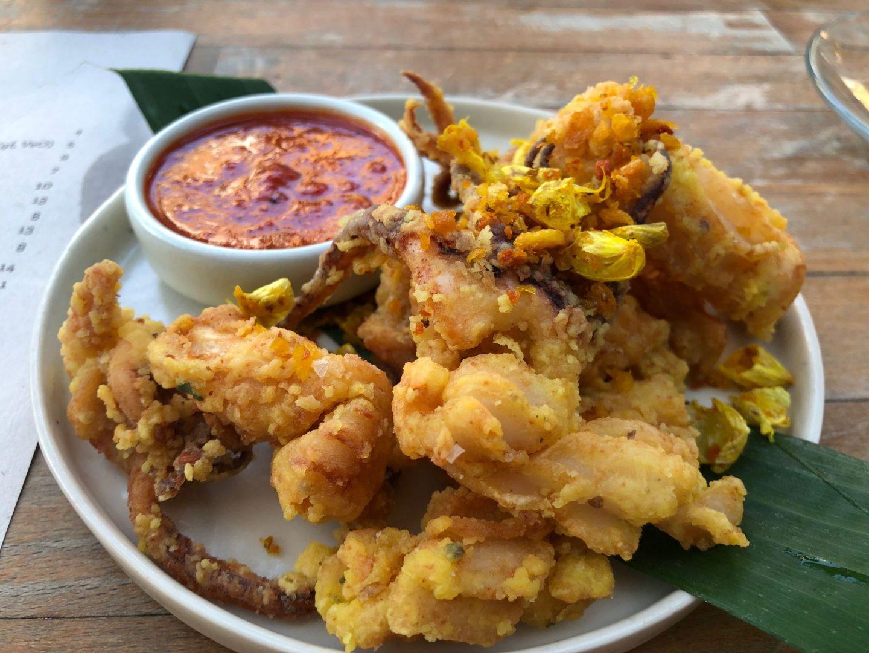 Red turmeric squid , kaffir lime leaf , Thai garlic , sour child sauce