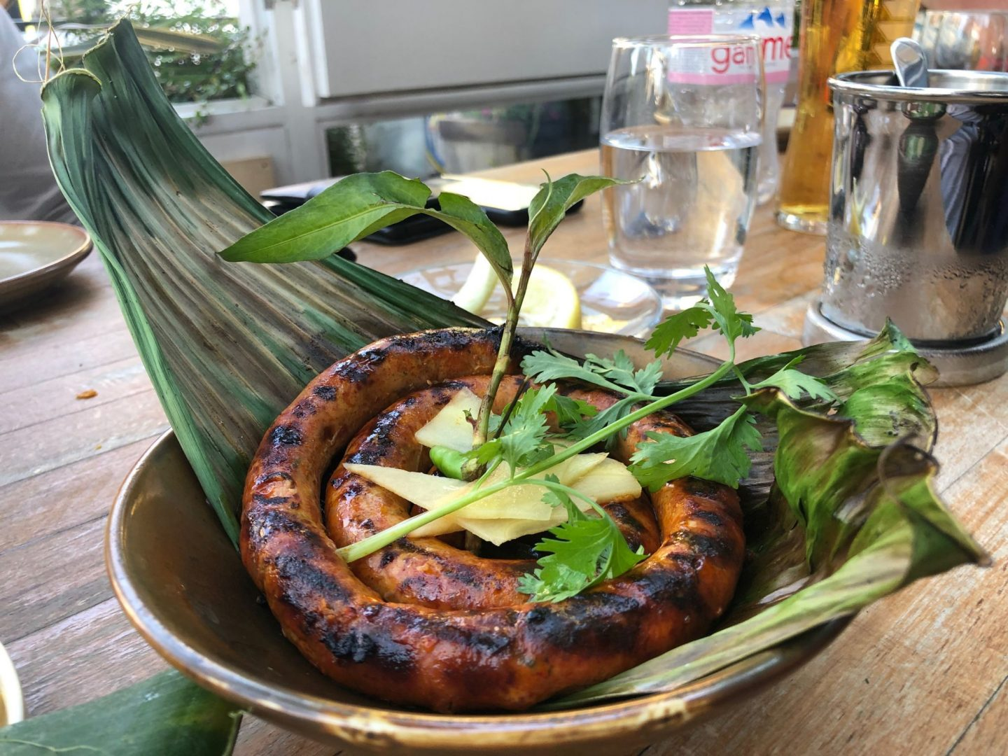 Northern Thai charcoal grilled sausage, ginger , Vietnamese mint