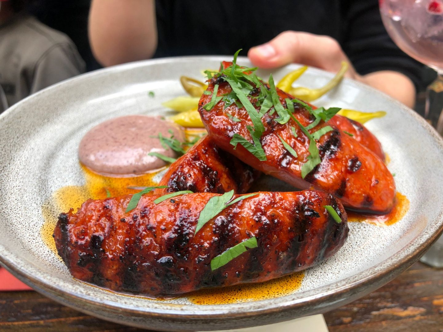 A plate of grilled chorizo and black olive mayo