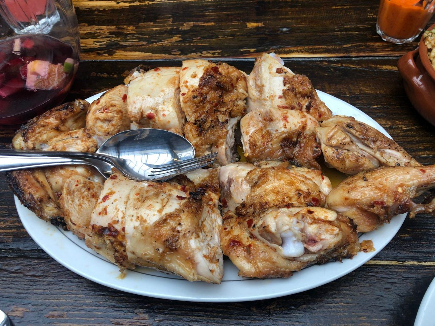Casa do Frango flame grilled Piri chicken carefully arranged on a plate