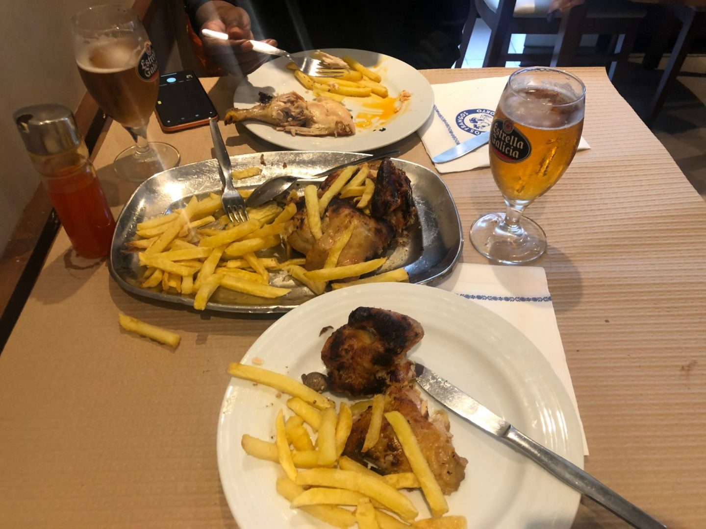 A whole Roast chicken and Fries to share and 2 beers costs €13.50