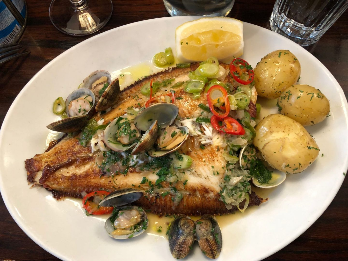 Whole Plaice, clams , chilli and spring onions